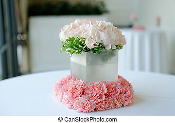 beautiful white wedding centerpiece - An image of a...