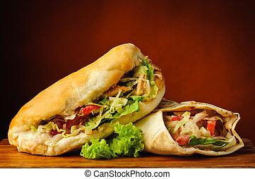 Shawarma and kebab - still life with shawarma and kebab on a...