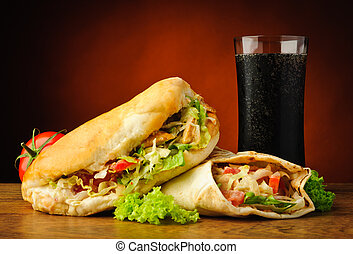 Turkish kebab, shawarma and cola drink - still life with...