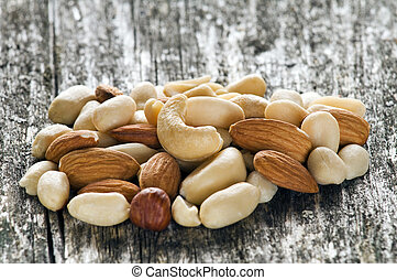 nuts - mixed nuts close up on wooden table
