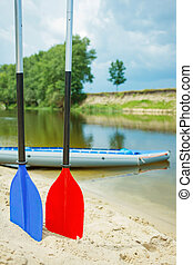 paddles for white water rafting - Red and blue paddles for...
