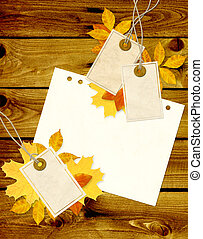 Grunge background with labels and autumn leaves