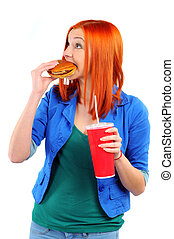 Fast food - young woman eating fast food isolated on white...