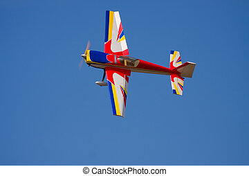 A model airplane performing stunts - A model airplane...