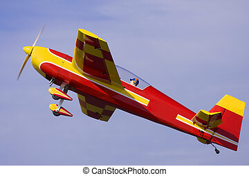 A stunt model airplane performs during a practice session
