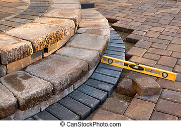Level on pavers - Pavers meets with patio steps and job...