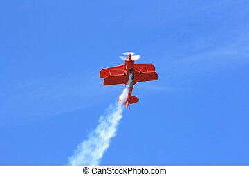 Aerobatics flight. - Double-wings sport aeroplane perform...
