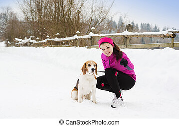 Woman with dog - Woman is walking during winter with her dog