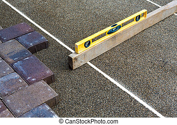 Pavers Ruler - Paving job gets done preciously leveling the...