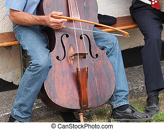 contra bass - man playing very old contra bass