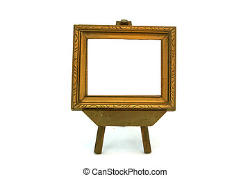 Masterpiece Ready - An empty gold frame sitting on an easel....