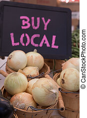 Organic White Onions in Baskets with Buy Local Chalkboard...