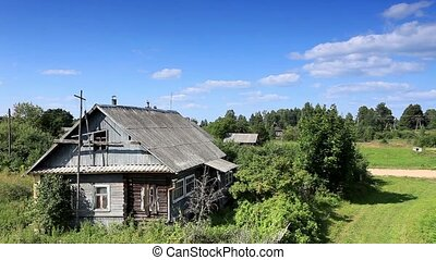 old Russian wooden houses - Movement of clouds over the old...