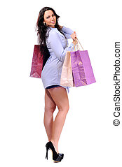 Shopping - woman holding shopping bags against white...