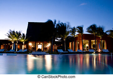 Luxury Resort and spa at sunset by the pool