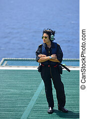 asian woman offshore helicopter pilot is on offshore oil rig