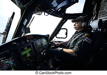 helicopter pilot in flight for oil rig operation - Offshore...