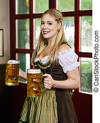 Oktoberfest waitress serving beer - Photo of a beautiful...