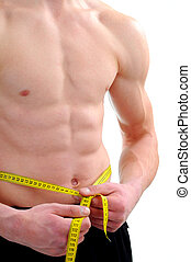Young Bodybuilder - Men with perfect abs measuring his waist...