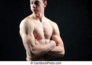 Young Bodybuilder - portrait of handsome muscleman against...