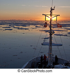 Midnight Sun in the Arctic Ocean off the east coast of...