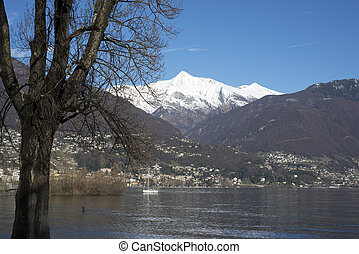 Alpine lake with snow-capped mountain