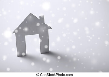 white paper house over white background - business and real...