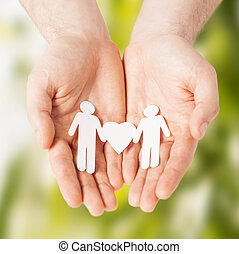 man hands with paper men - eco, bio, nature, love, harmony...