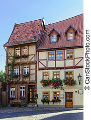 the street with half-timbered houses in Quedlinburg,...