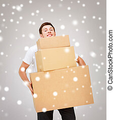 young man carrying carton boxes - delivery, post, package...