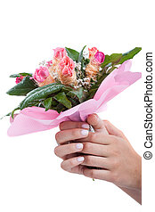 Woman's hands with bouquet of flowers