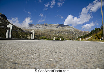 Road with mountain and blue sky with clouds