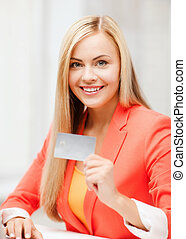 businesswoman with laptop using credit card - business and...