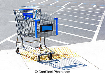 Shopping cart on parking lot.