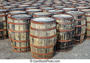 Stacked whisky casks and barrels - Detail of stacked whisky...