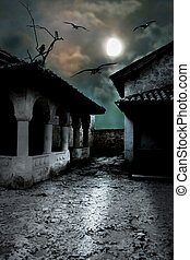 Scary dark courtyard in the ominous moonlight night in a...