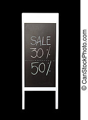 30 and 50 discount sign written with chalk on blackboard...