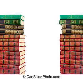 A stack of old books with gold stamping on a white...