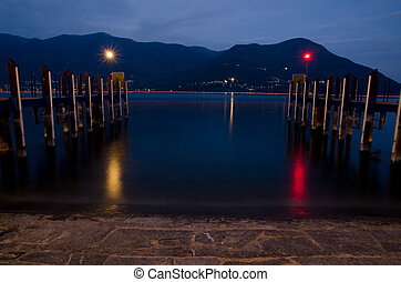 Port at night on an alpine lake with mountain