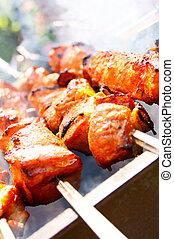 Juicy meat shish kebab on coals.