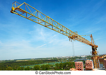 tower crane over blue sky - Two buildings construction tower...