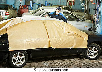 repairman sanding car roof