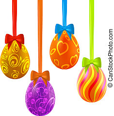Colorful easter eggs hanging on ribbons with bows
