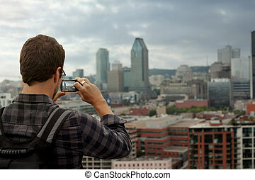 Man Taking a Picture of Downtown Montreal - Man Taking a...