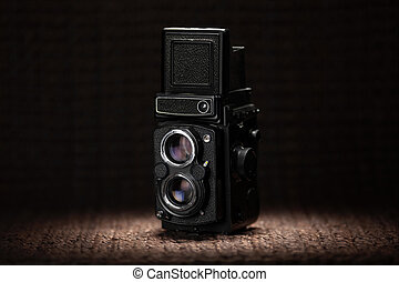 Old medium format camera under a spot light - Vintage medium...