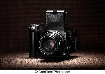 Old medium format camera under a spot light - Vintage medium...