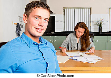 Couple getting their Personal Finance in order - Young man...