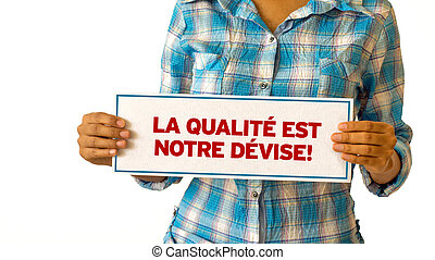 We focus on quality In French - A woman holding a We focus...