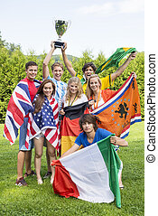 Athletes With Various National Flags Celebrating In Park -...