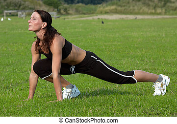 woman workout - healthy young woman is doing a workout in...